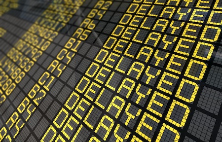 International Airport Board Close-Up displaying flight is delayed
