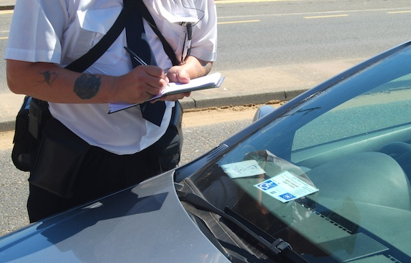 Parking warden issues a fine but parking ticket appeals are on the rise