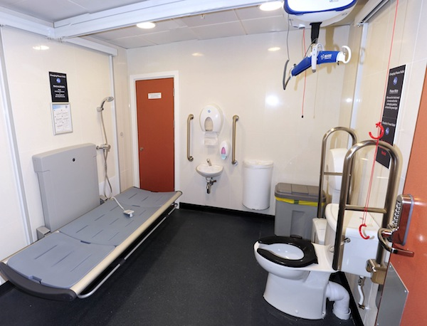 Birmingham Airport Changing Places facility which includes height adjustable benches, a hoist & more