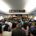 People walk through busy terminal
