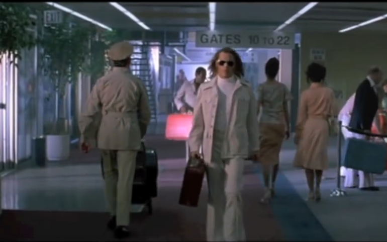 Not many people can strut through an airport like Johnny Depp can...but can you guess the film?