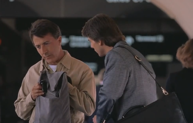 This smart fellow is causing his brother all kinds of grief in this airport movie scene