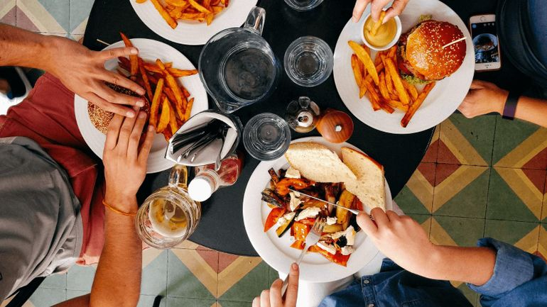 group of friends eating burgers and chips